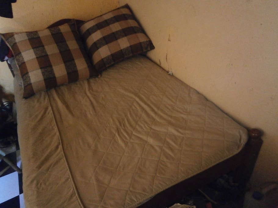 Wooden bed and two pillow made from sisal