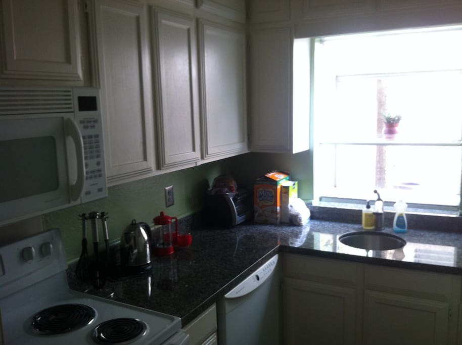Small kitchen with granite counter tops and all appliances. Fresh paint and outlets.
