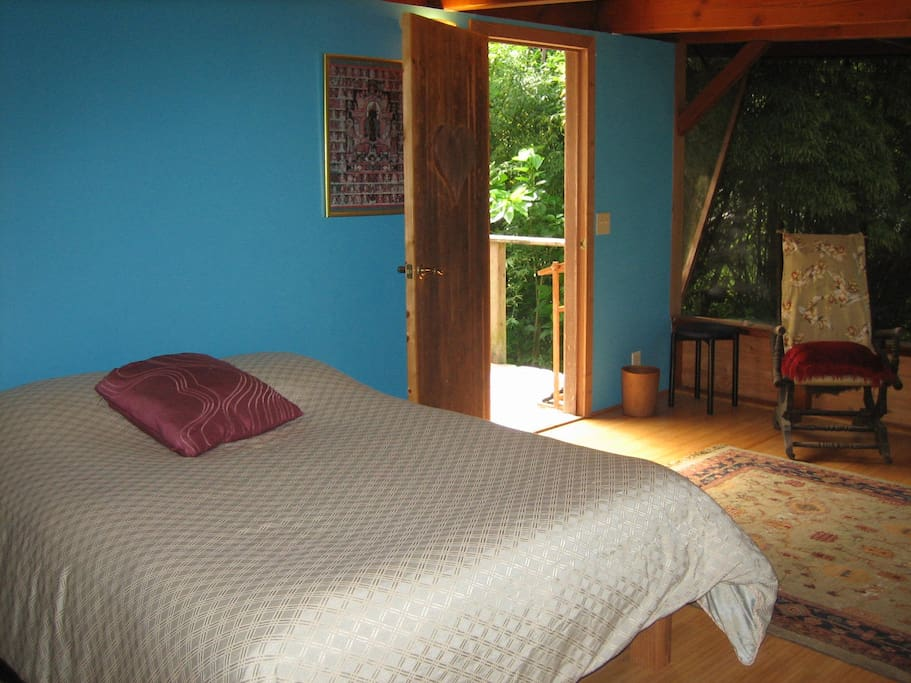 Second bedroom with a double bed and door that leads to the shower deck