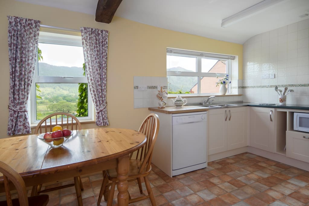 Upstairs the fully equipped kitchen has a dining table and sink with a view (and a dishwasher, don't worry!).