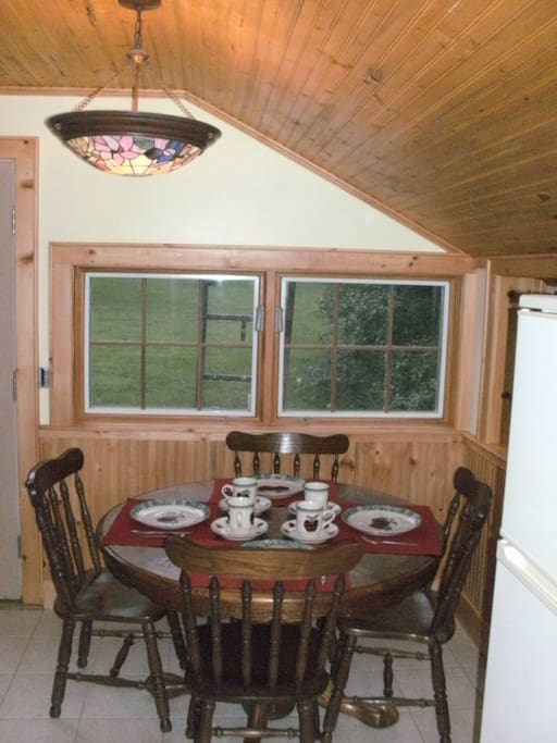 Dine in kitchen with windows that overlook the nearby stream.