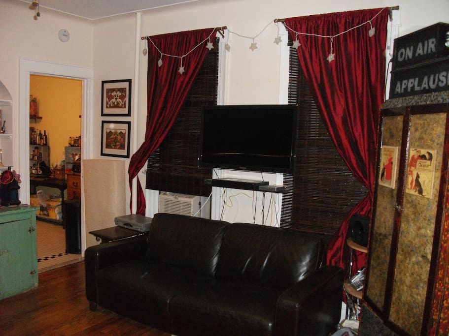 other side of the living room, where the shared flat-panel HD television is (w/cable)...