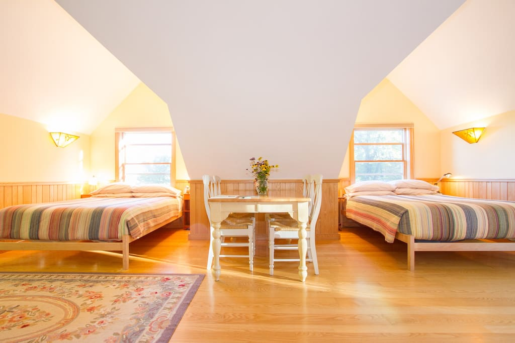 Two queen-size beds in their own cozy alcoves make the Deluxe Barn Suite a special spot!