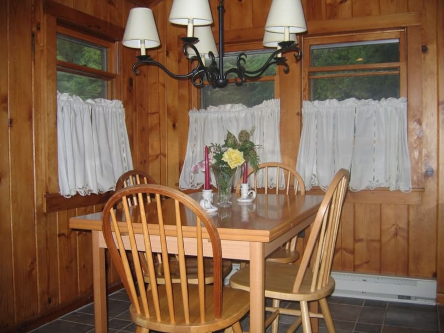 The dining room was the last addition to the cabin and features a picture window.