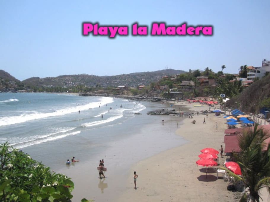just 100 steps to famous La Madera beach with cocktails palapas and restaurant services