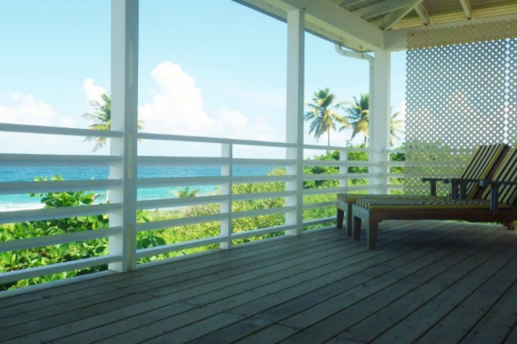 Relax on the balcony - with the most stunning views across the pool and beach!