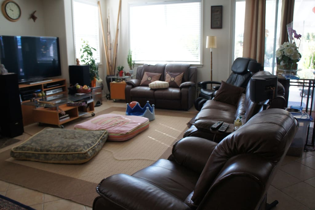 Family room with comfortable sofas and masssage chair and big flat screen TV with Netflix