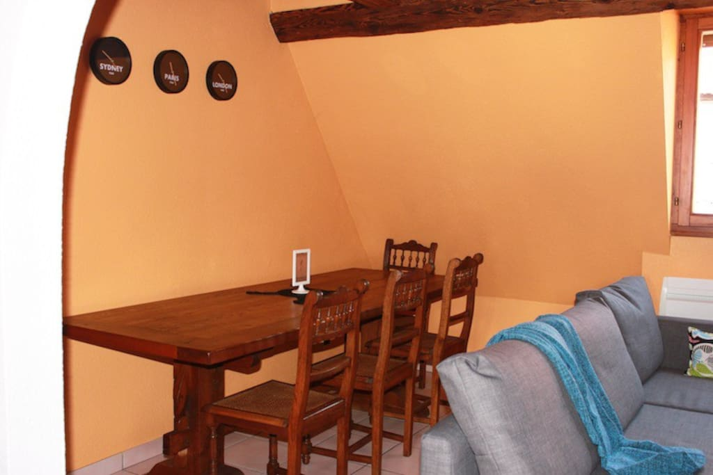 Dining and living area. Hand-made oak table. Sits five.