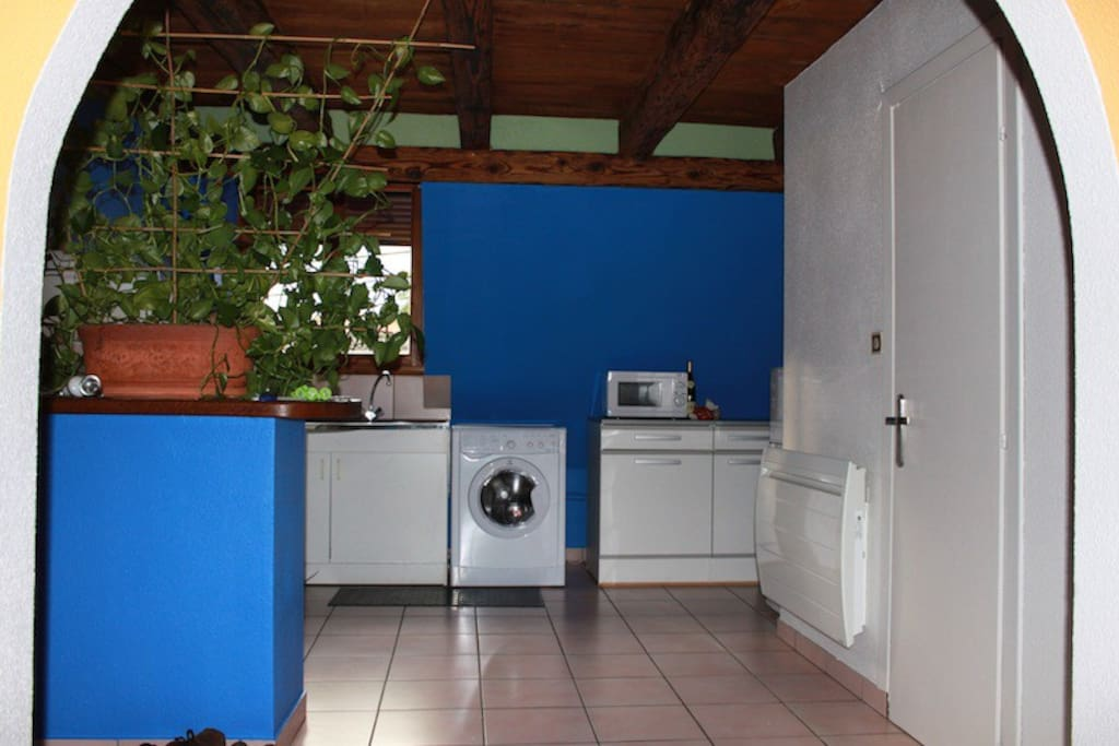 Kitchen, with washer/dryer, microwave, fridge, oven.