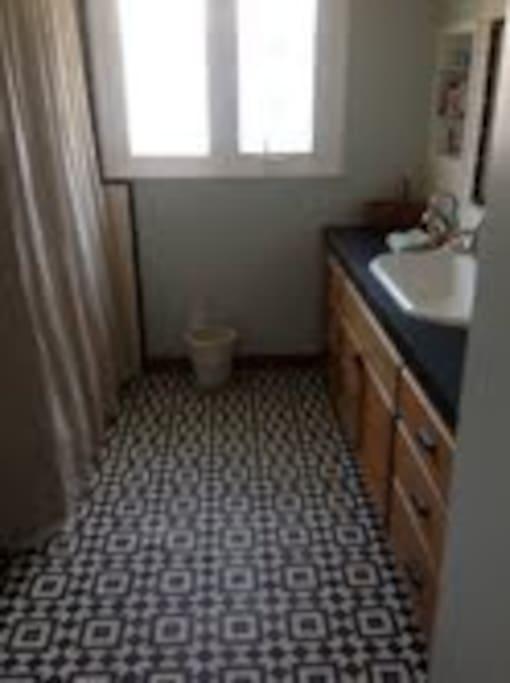 Roomy renovated retro bathroom