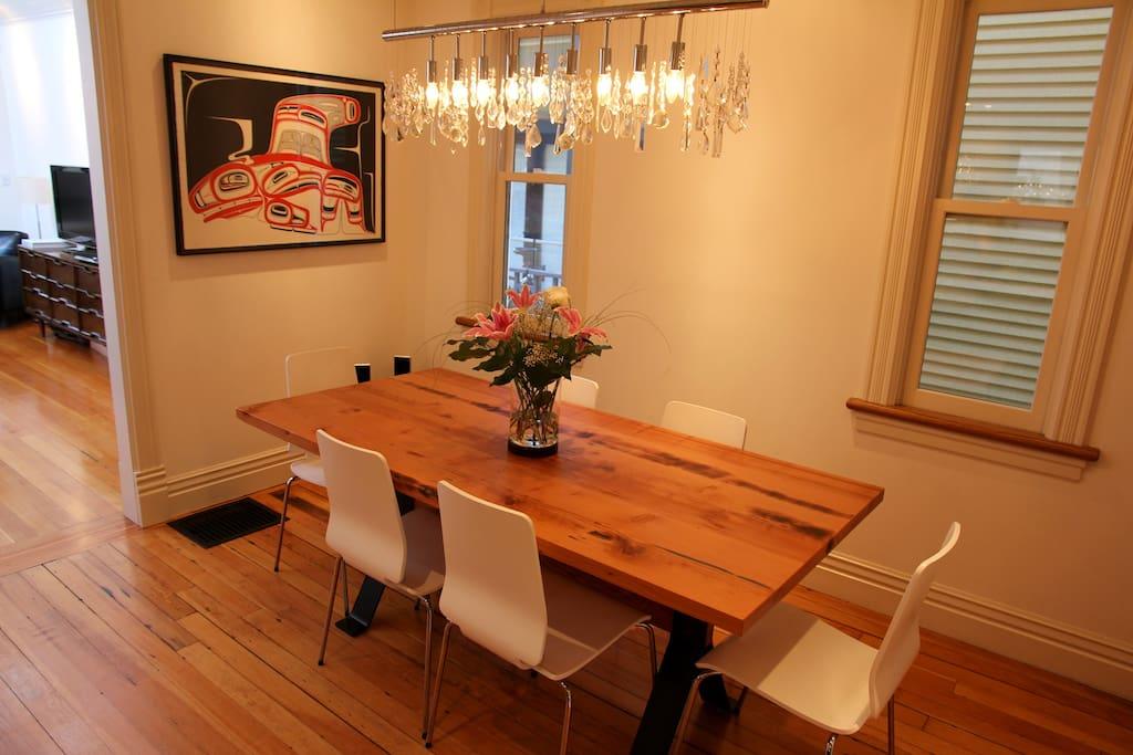 dining room - reclaimed wood table made from timbers salvaged from the gastown fire of 1886