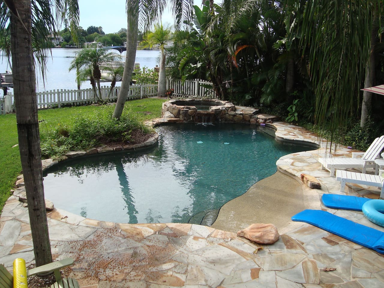 Landmark natural pond heated saltwater pool with 10 person hot tub and soothing waterfall.