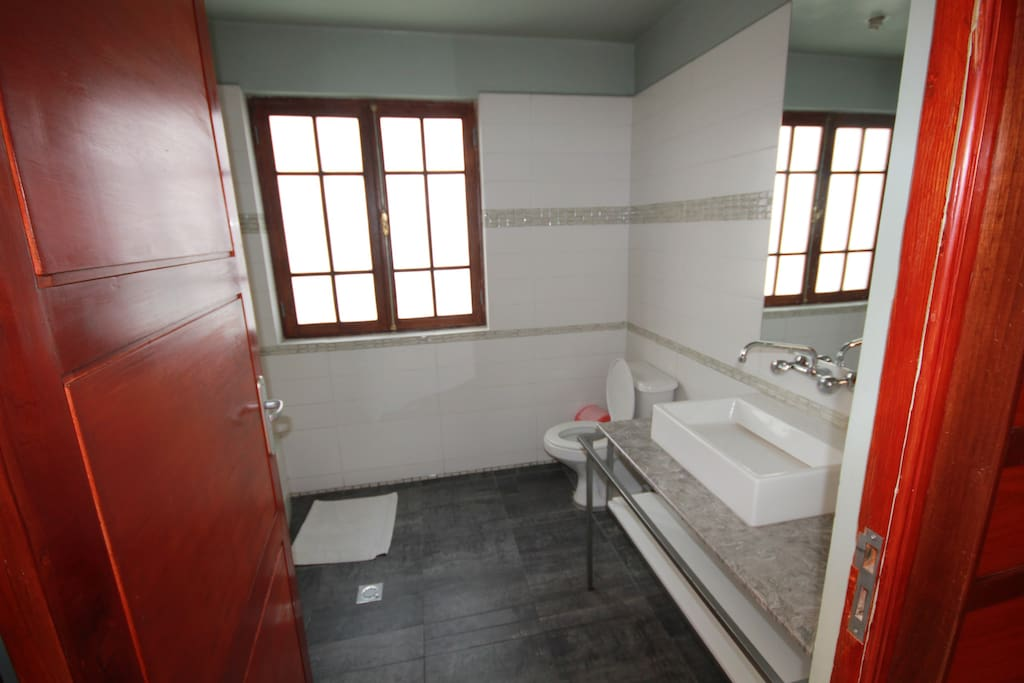 Recently renovated bathroom with heating and a shower heated by both gas and electric heating.