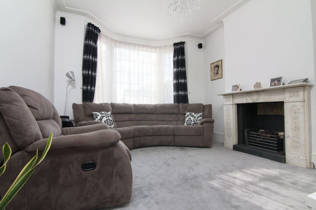 Reclining chairs. Hit the button and relax back in the sofa. Beautiful fireplace for those winter evenings. Thick soft carpet