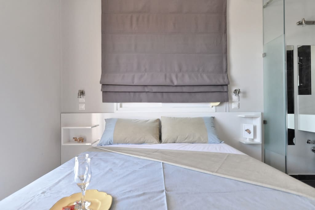 Double bed with a Dunlopillo mattress.