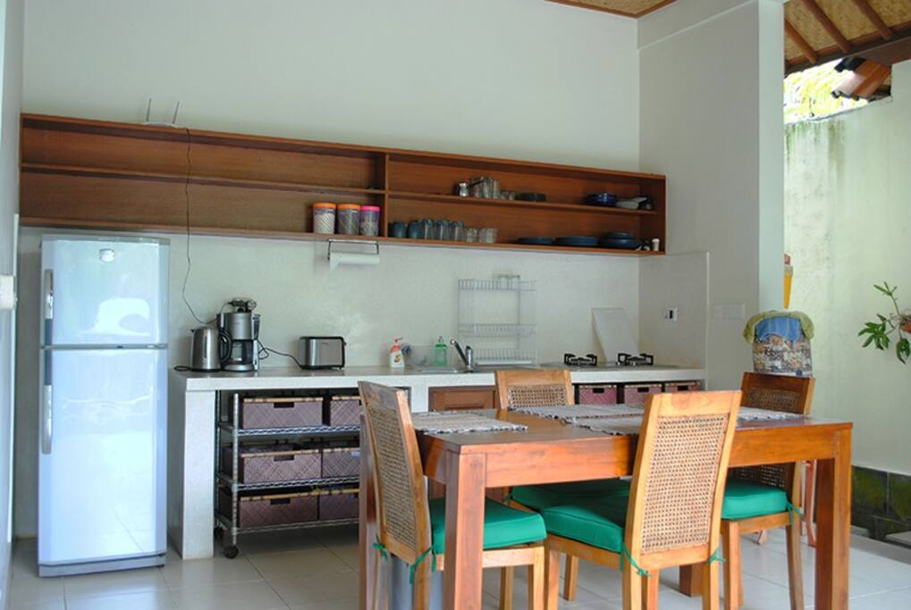 The fully equipped kitchen has adjacent dining.