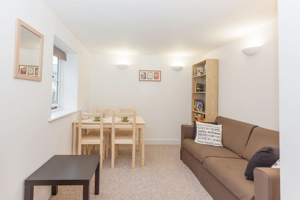 The living room is fully equipped with a comfortable sofa, flat screen television, free view, DVDs, books and games.