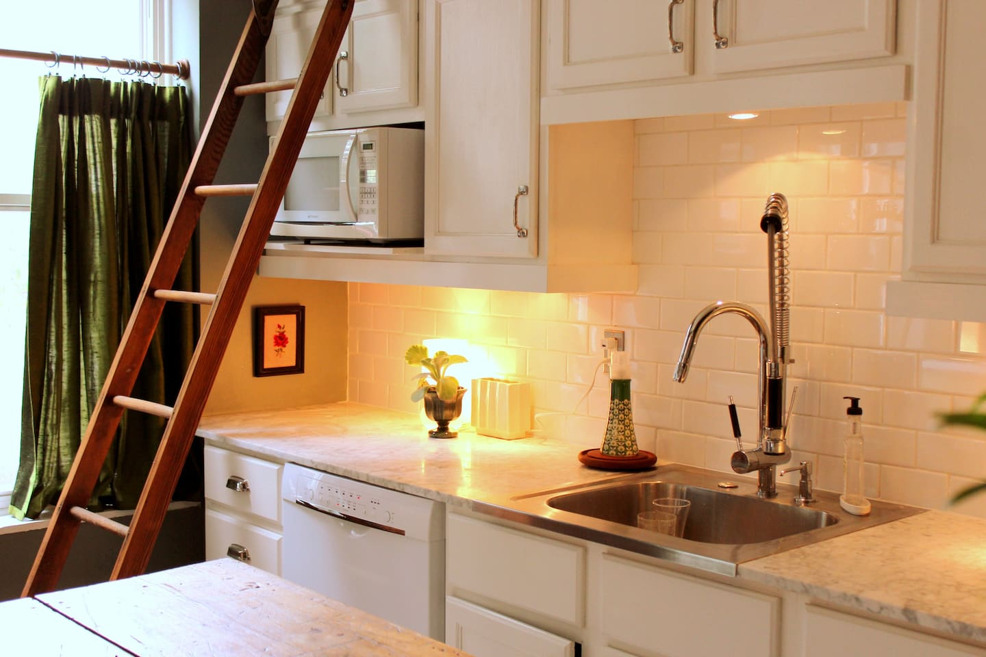 marble countertops salvaged from an old city building, dishwasher and large bowl stainless sink
