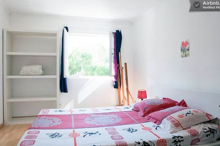 Bright Bedroom in villa with garden
