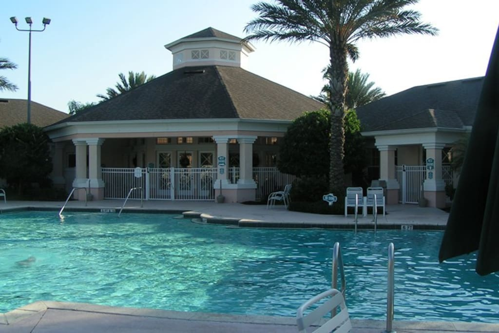 Windsor Palms community club house pool area. Heated throughout the year except during the summer when it is naturally heated. Has an olympic length swimming pool, hot tub (spa), children's wading area.