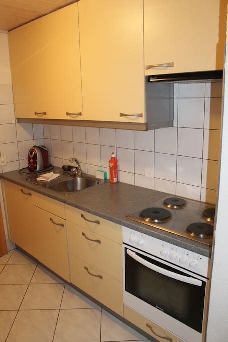 Kitchenette with stove, oven and coffee machine