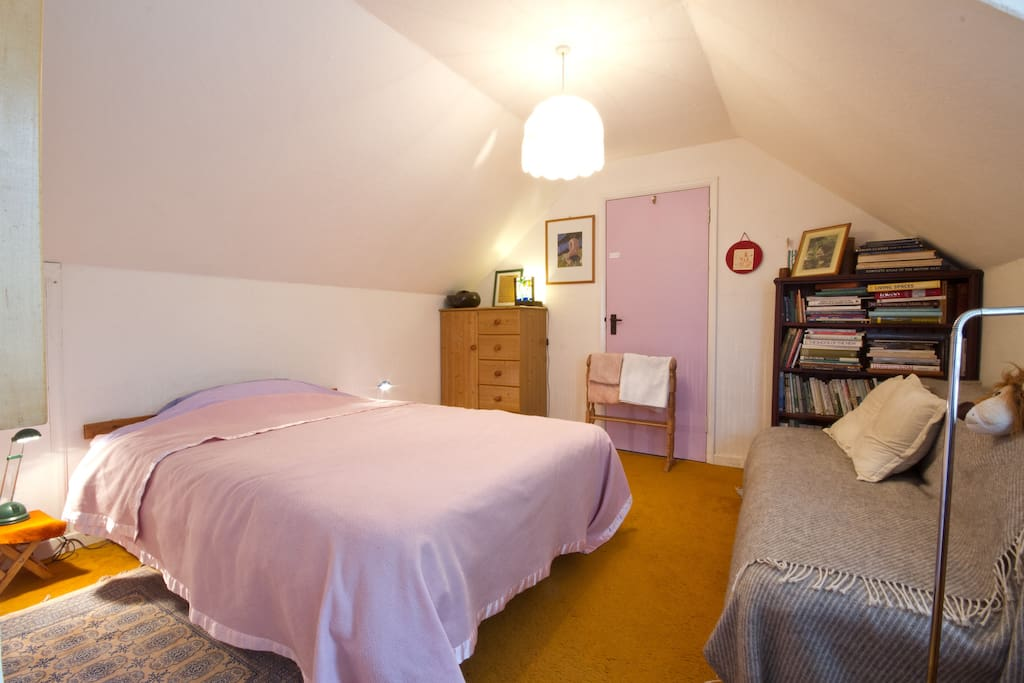 Double bedroom upstairs with tallboy for your clothes and a cosy sofa area for reading.