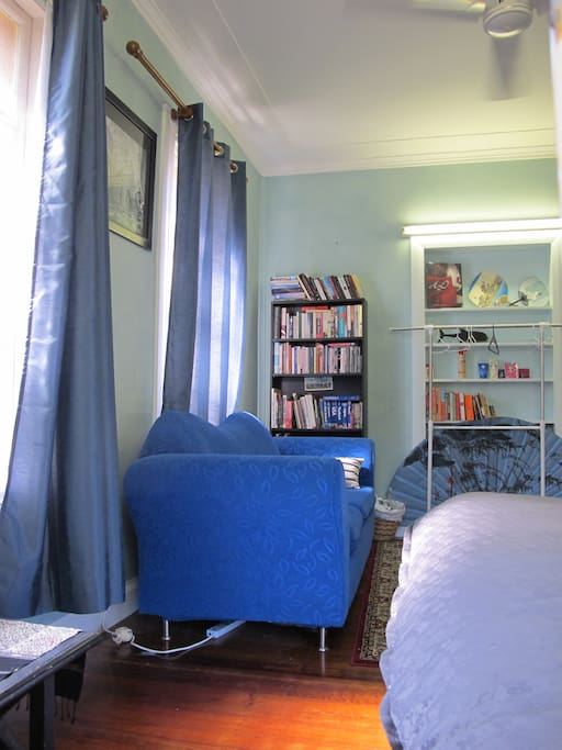 Lots of books to borrow and a comfy couch to read them on. It also folds out into a double bed