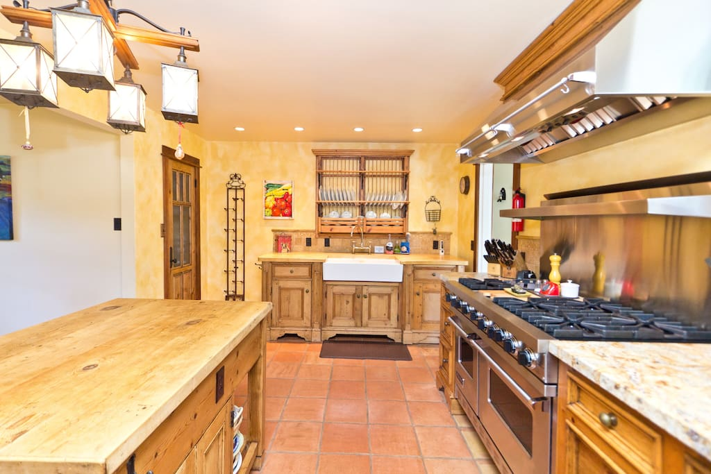 The heart of the gourmet kitchen featuring oiled-oak island prep station, Viking 6-burner range with double ovens.