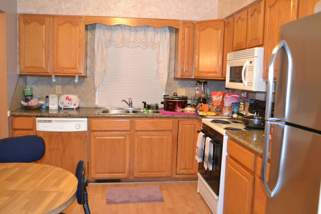 kitchen with stove, refrigerator, microwave, coffee maker, and toaster.