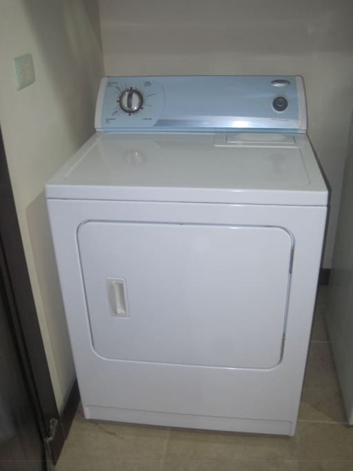 The washer dryer unit conveniently located near the family room