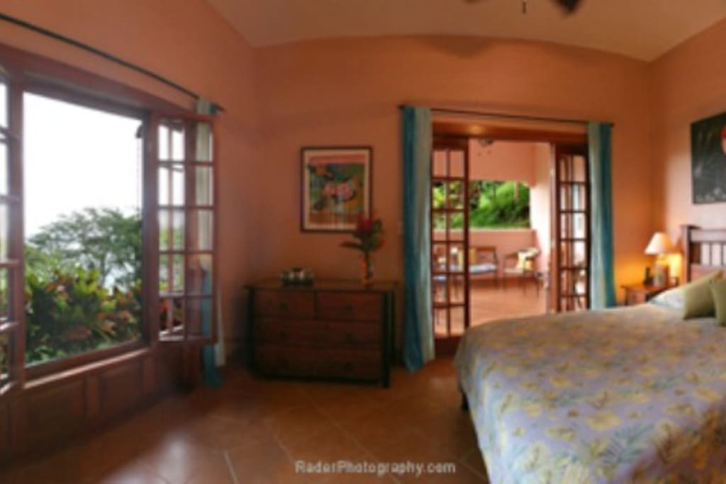 The bedroom in the Las Rocas Abajo suite with french doors leading to your patio