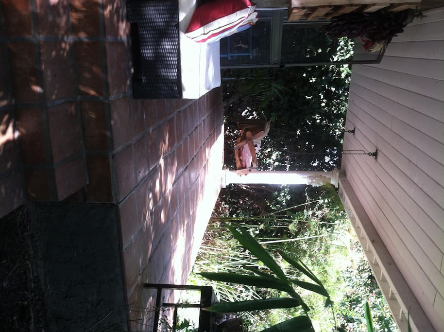 Saltio Tiled porch with swing and Matthew Brown Landscaped front yard