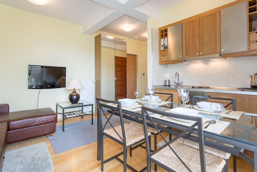 Spacious living room with dining area and kitchenette