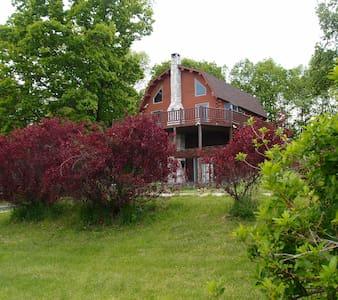 Log cabin on a tranquil hillside - Hudson