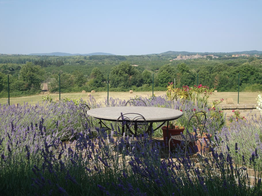 Outdoor local stone table with views over countryside with hay bales in field