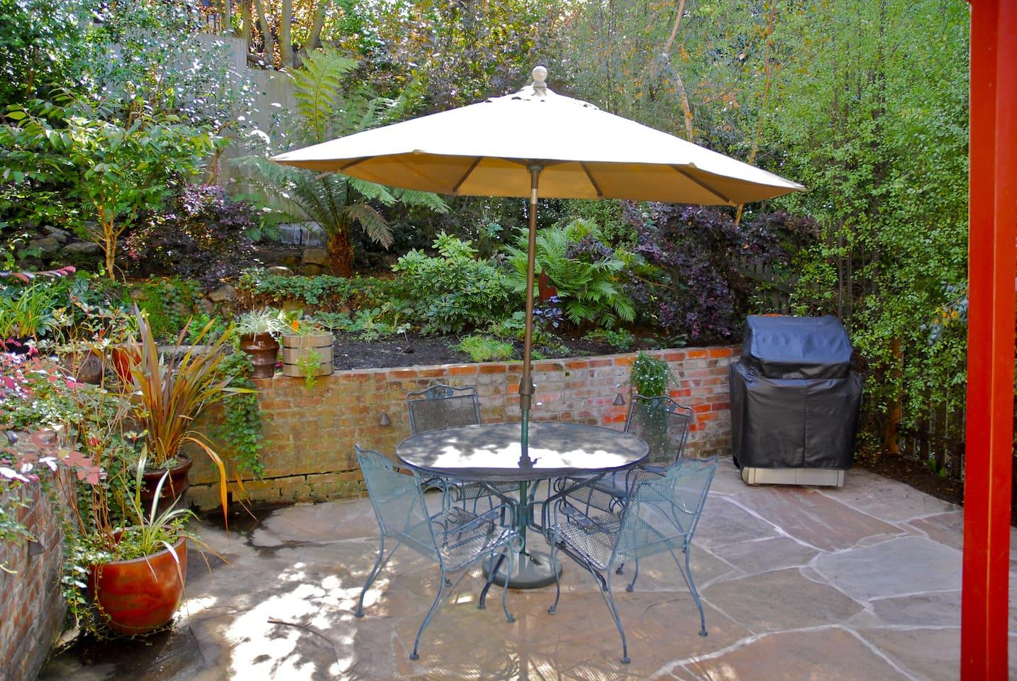 Enchanting Patio Overlooking a lush garden!