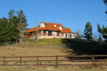 adobe horse ranch in the mountains