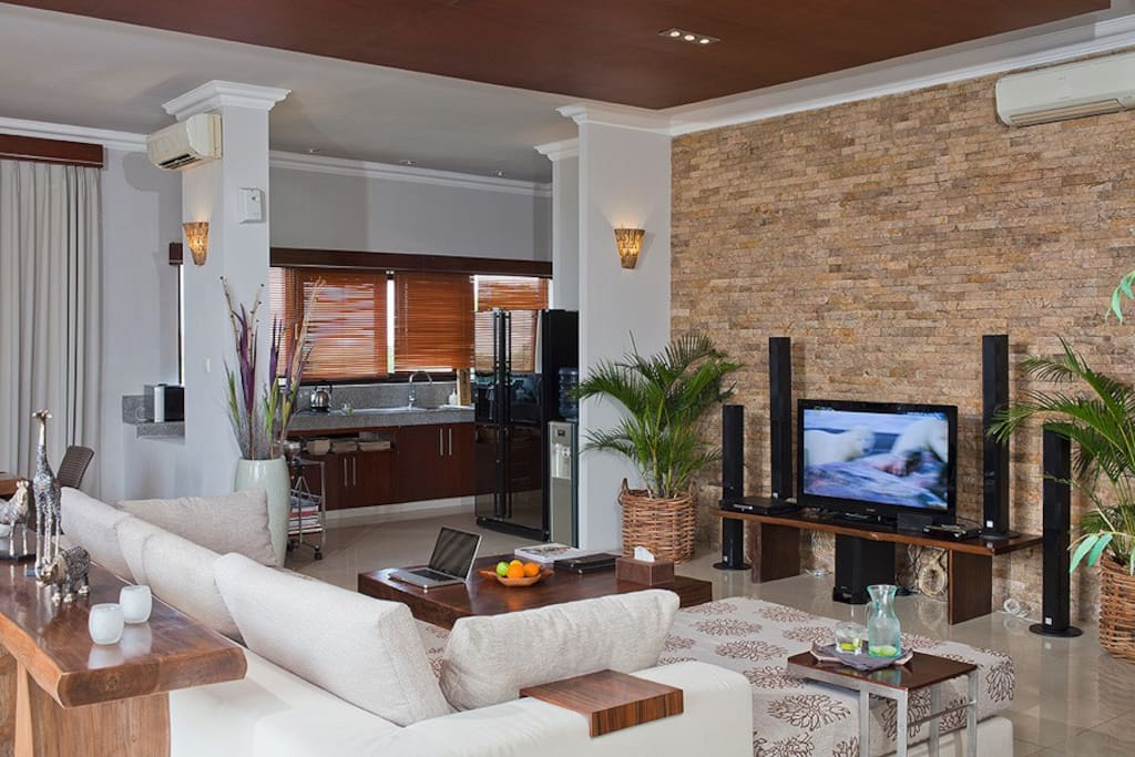 Living area of Sky House with ample sofa space, TV, kitchen, dining and guest toilet.