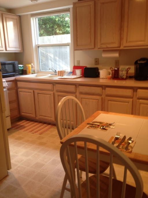 Partial kitchen with many amenities (see written description) including a Keurig machine and complimentary coffees and teas.   In the fridge, enjoy a beer, fruit and cheese and crackers!