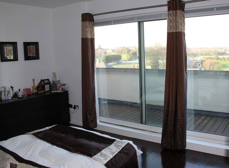 One bedroom with access to the balcony