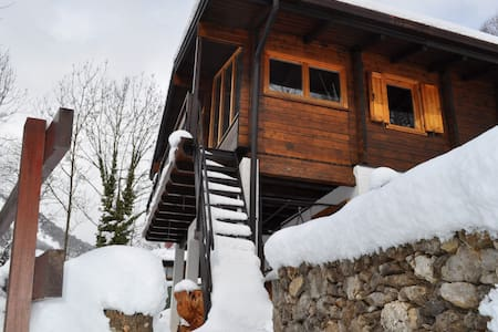 Typical alpine chalet surrounded by - Bed & Breakfast