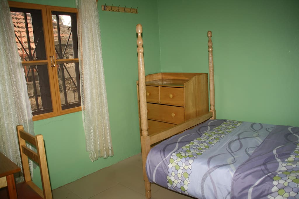 elephant room-double sized bed suitable for 2 persons, linens and mosquito nets provided
