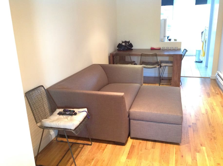 Sofa/bed, ottoman and dining table
