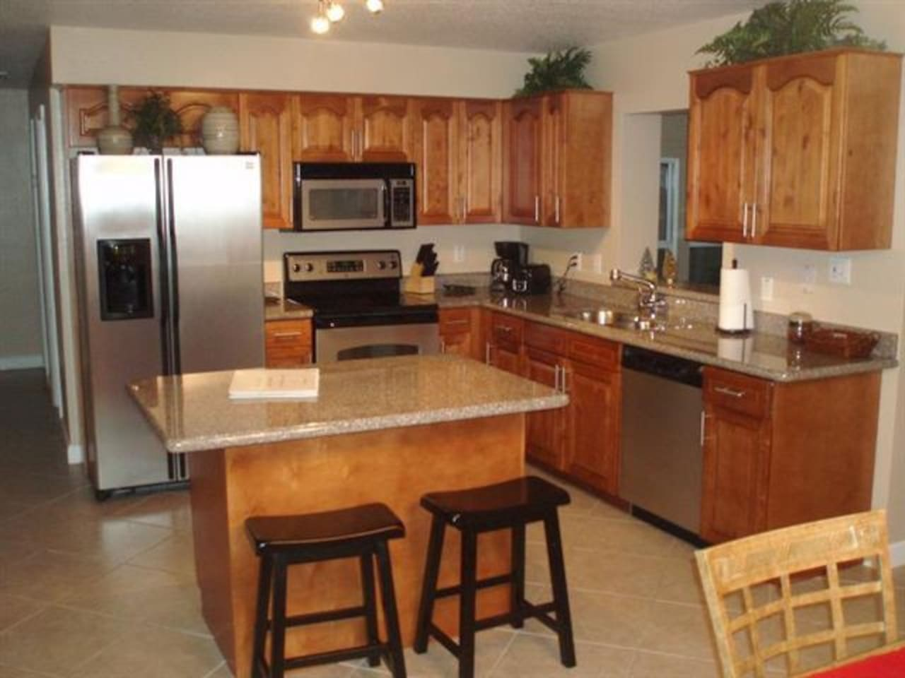 Eat in Kitchen with stainless steel appliances and honey maple cabinets
