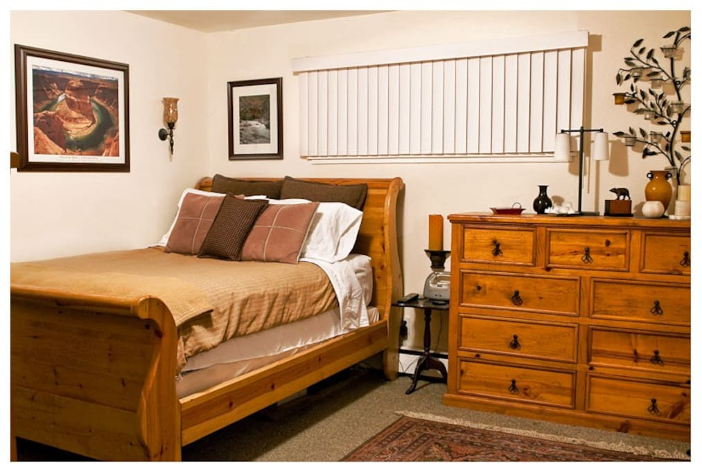 Comfy bedroom with clean linens, wood furnishings, and plenty of quiet.  A restful night's sleep awaits.