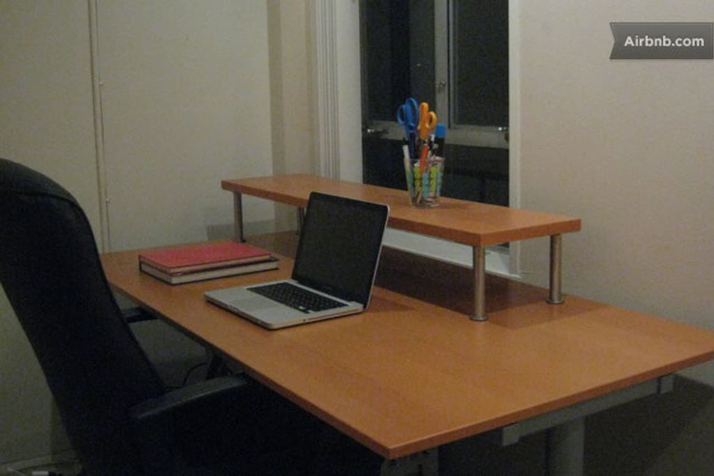 Large desk and chair in your room to get work done.