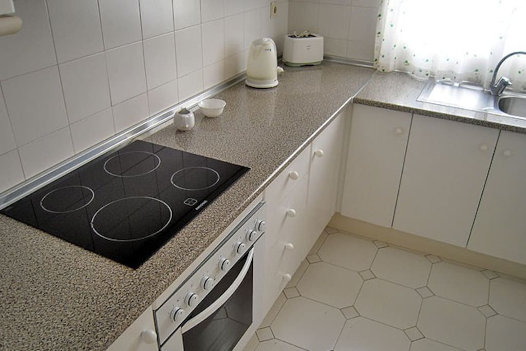 Clean, fully equipped kitchen with oven, hob, washing machine, microwave, fridge, toaster, coffee maker and kettle, plus all the cutlery, crockery and cooking utensils you'll need.