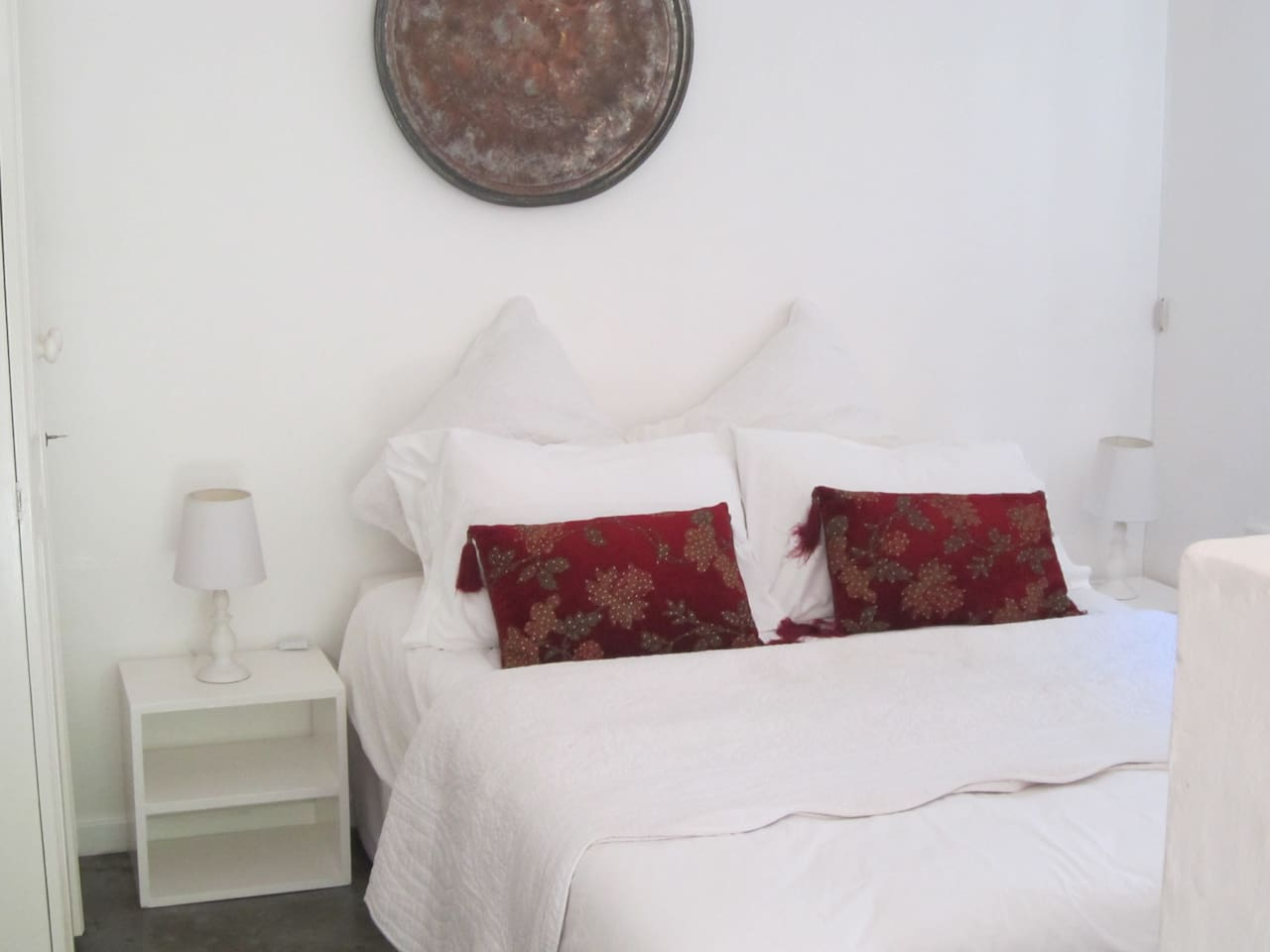 Double bed with fresh white linen changed weekly.