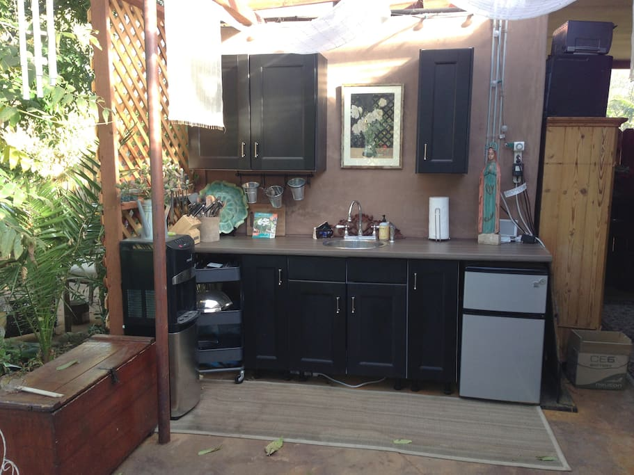 Outdoor kitchenette had little refrigerator, microwave and small appliances