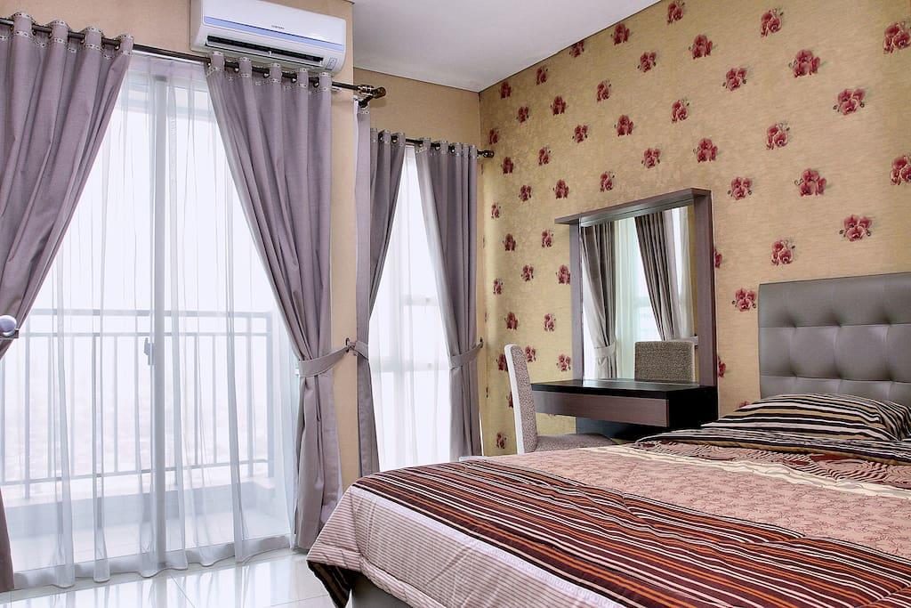 Bedroom with glass door to balcony